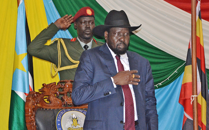 FILE: South Sudan's President Salva Kiir stands for South Sudan's national anthem before signing a peace agreement in the capital Juba, on 26 August, 2015. Picture: AFP.
