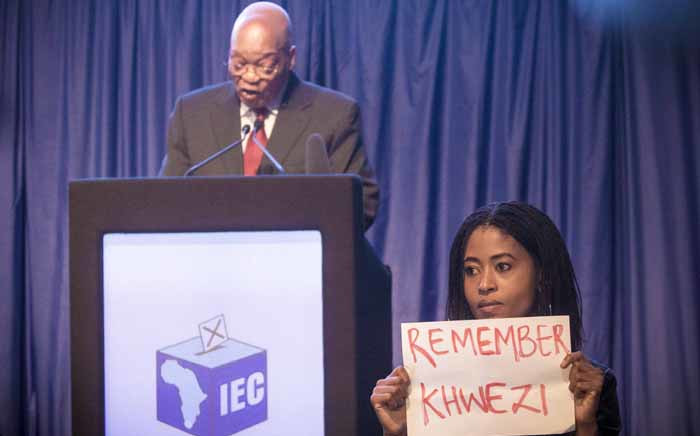 One of four women who staged a silent anti-rape protest during President Jacob Zuma's address at the IEC briefing on 6 August 2016. Picture: Thomas Holder/EWN.