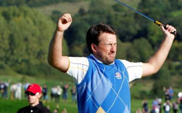 Europe Ryder Cup player Graeme McDowell celebrates on the 17th green after making the winning putt on 4 October 2010. Picture: Peter Muhly/AFP PHOTO