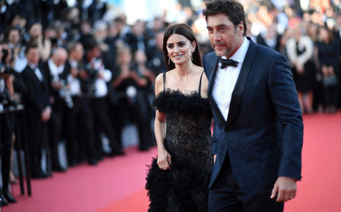 """Spanish actress Penelope Cruz and Spanish actor Javier Bardem pose as they arrive on 8 May 2018 for the screening of the film """"Todos Lo Saben (Everybody Knows)"""" and the opening ceremony of the 71st edition of the Cannes Film Festival in Cannes, southern France. Picture: AFP."""