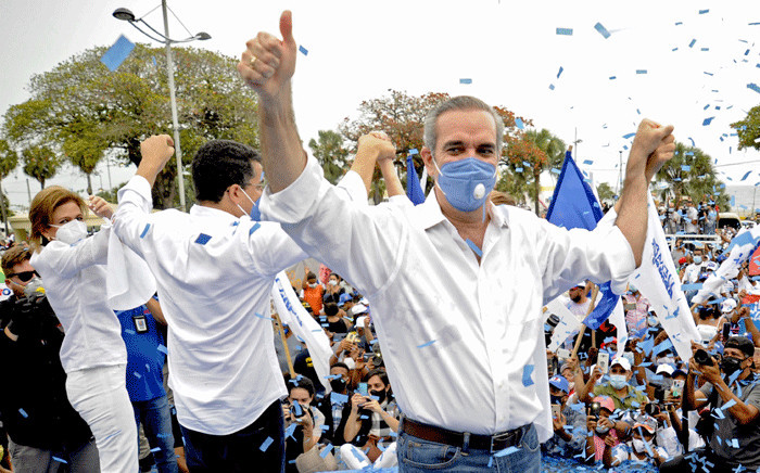 Handout photo released by Dominican opposition presidential candidate for the Modern Revolutionary Party (PRM) Luis Abinader's Press Office of him (R) giving the thumb up during a campaign rally in Santo Domingo on July 1, 2020.  Picture: AFP