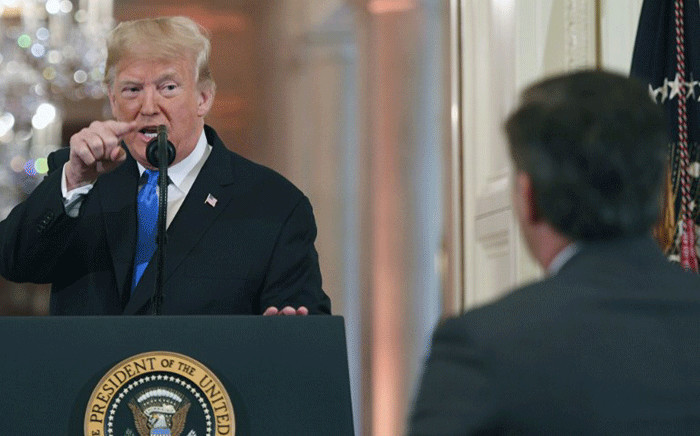 US President Donald Trump points to journalist Jim Acosta from CNN during a post-election press conference in the East Room of the White House in Washington, DC on 7 November 2018. Picture: AFP.