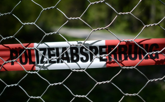 FILE: Police marking tape is seen at the perimeter fence. Picture: AFP.