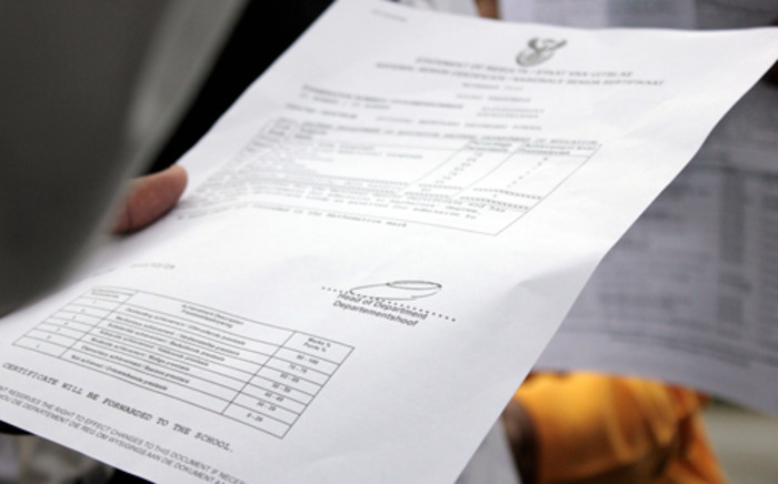 FILE: A pupil holds his matric report card on 3 January, 2013. Picture: Sebabatso Mosamo/EWN.