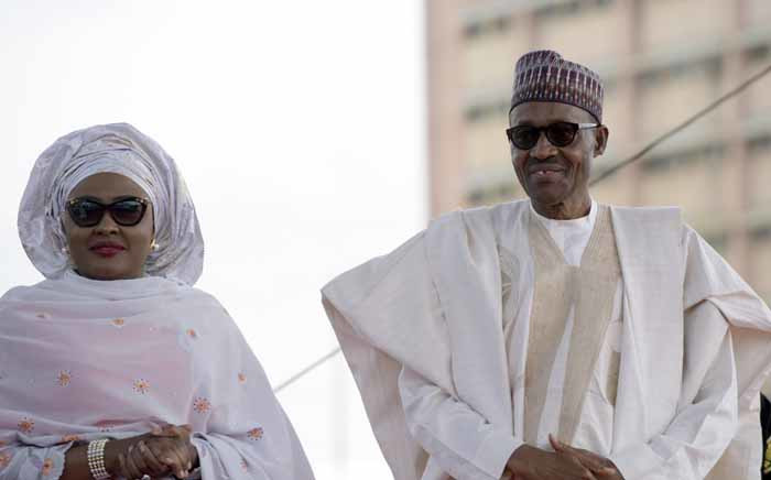 Nigerian President Mohammadu Buhari with his wife Aisha before taking his oath of office at the Eagles Square in Abuja on 29 May 2015. Picture: AFP.
