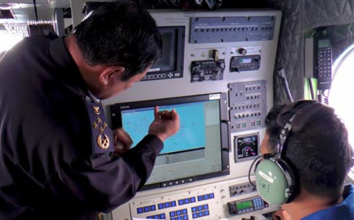FILE: Malaysian Maritime Enforcement personnel using radar to scan for the missing Malaysia Airlines (MAS) Boeing 777-200 as they fly over the waters off the northeastern coast of peninsula Malaysia. Picture: AFP