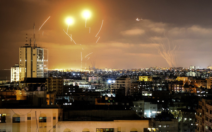 Rockets fired towards Israel from Gaza City, controlled by the Palestinian Islamist movement Hamas, are intercepted by Israel's Iron Dome Aerial Defence System on 10 May 2021. Picture: MAHMUD HAMS/AFP
