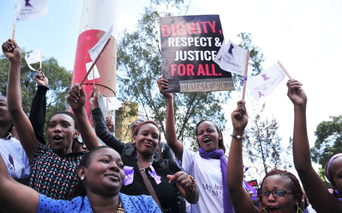 Women chant during a rally in protest against violence towards women, on November 17, 2014 in the Kenyan capital Nairobi. Picture: AFP.