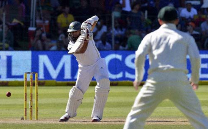 South Africa's batsman Hashim Amla plays a shot from Australia's cricketer Ryan Harris during the second test match between South Africa and Australia at Saint George's Park in Port Elizabeth on February 22, 2014. Picture: AFP.
