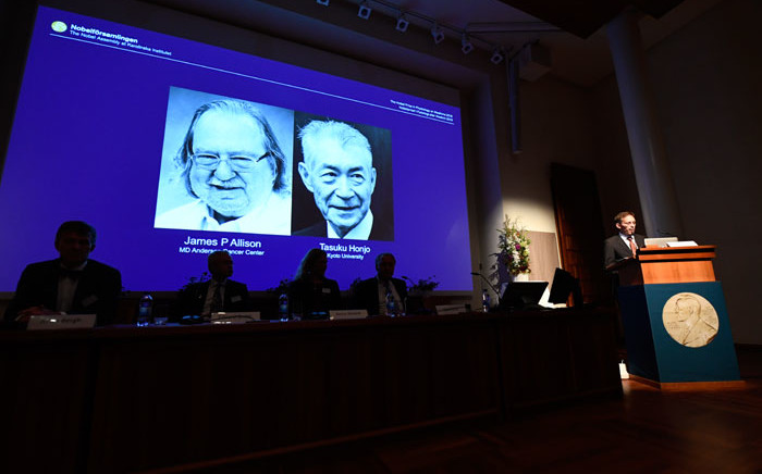 James P Allison of the US and Tasuku Honjo of Japan are announced as the winners of the 2018 Nobel Medicine Prize on 1 October 2018. Picture: AFP