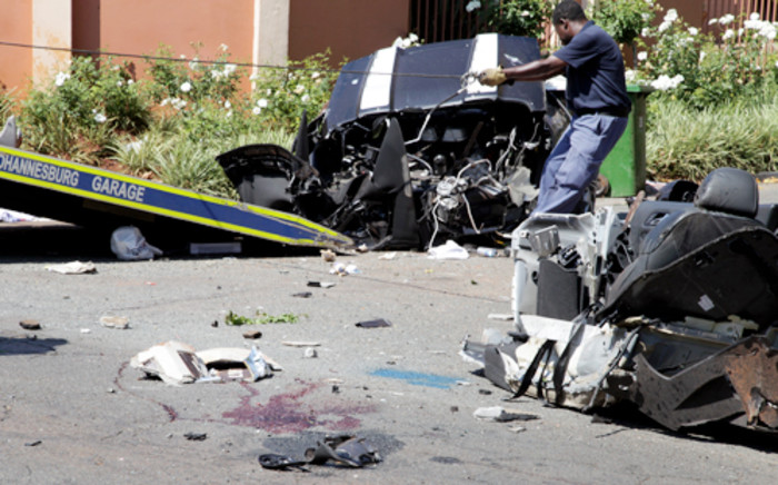 A driver and an officer were killed during a crash on Oxford Road. Picture: Sebabatso Mosamo/EWN