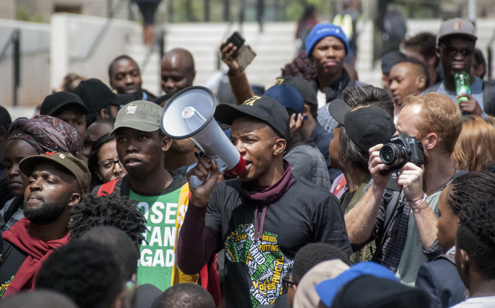 A student leader at Wits University addesses the crowd outside the science dept after the announcement of an 8% increase in fees by Min of Higher Education Nzimande. Picture: Nina Leslie/EWN