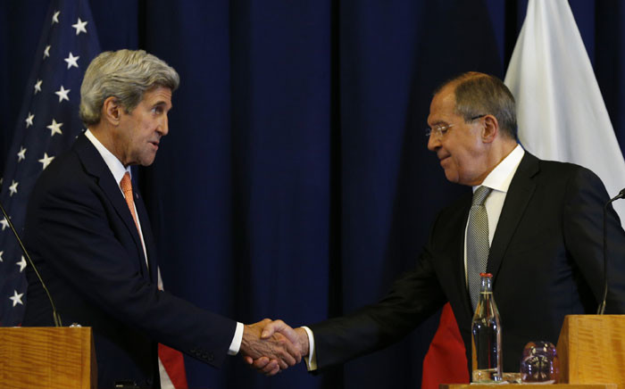 US Secretary of State John Kerry and Russian Foreign Minister Sergei Lavrov shake hands at the conclusion of their press conference following their meeting in Geneva where they discussed the crisis in Syria. Picture: Pool/AFP.