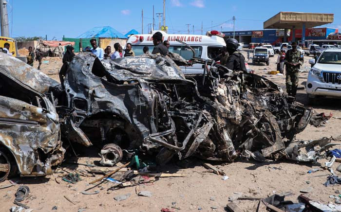 The wreckage of a car that was destroyed during the car bomb attack is seen in Mogadishu, on 28 December 2019. A massive car bomb exploded in a busy area of Mogadishu on 28 December 2019, leaving at least 90 people dead, many of them university students. Picture: AFP.