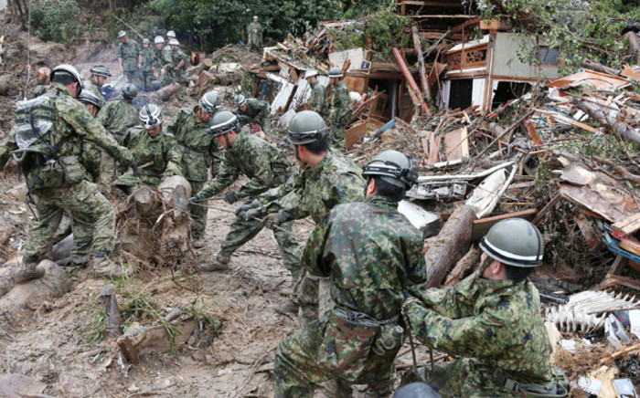 Defense personnel search for victims in mud two days after a landslide hit a residential area in Hiroshima, western Japan on late 22 August, 2014. Picture: AFP.