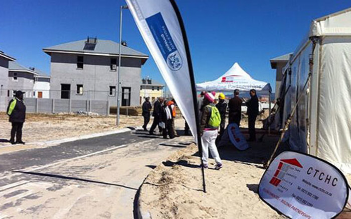 First five families received keys to their homes in Harmony Village housing project on 2 September 2013. Picture: Siyabonga Sesant/EWN