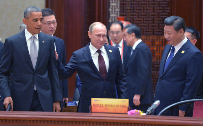 US President Barack Obama, Russian President Vladimir Putin and Chinese President Xi Jinping attend the APEC economic leaders meeting in Beijing, China, on 11 November 2014. Picture: EPA