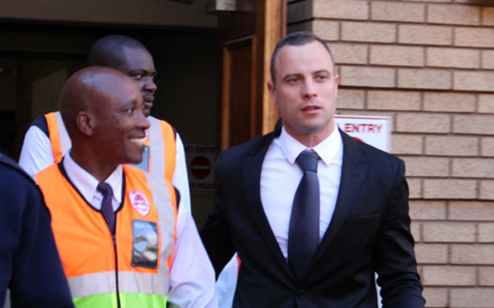 Oscar Pistorius leaves the High Court in Pretoria after his murder trial on 12 May 2014. Picture: Christa Eybers/EWN.