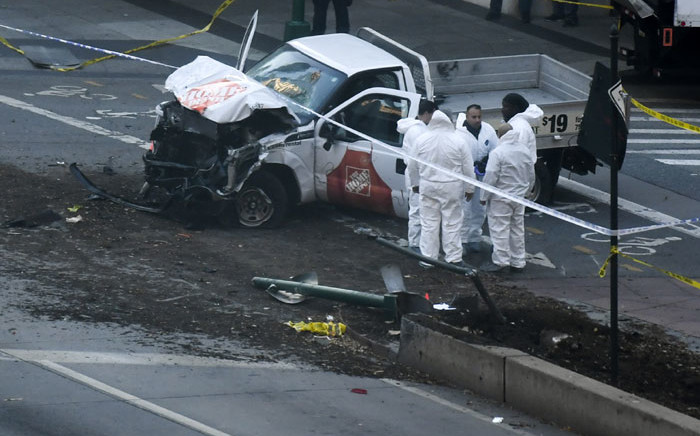 FILE: Investigators inspect a truck following a terror attack incident in New York on October 31, 2017 in which 8 people were killed. Picture: AFP