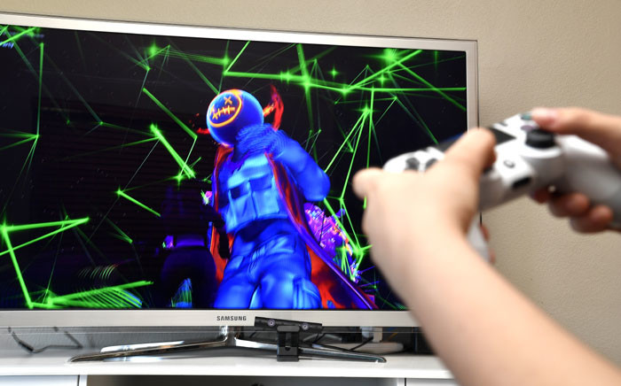 A gamer plays Fortnite featuring Travis Scott Presents: Astronomical on 23 April 2020 in Los Angeles, United States. Picture: AFP