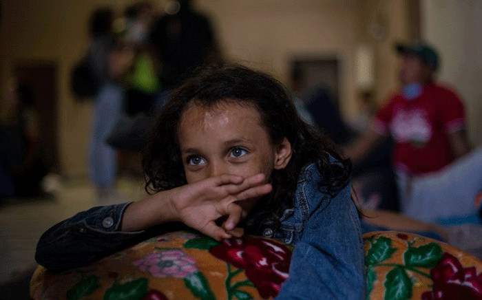 "Honduran Ashley, 8, rests at the Hotel Migrante shelter in Mexicali, Mexico, on 24 April, 2018, after arriving with other Central American migrants taking part in the ""Migrant Via Crucis"" caravan. Picture: AFP"