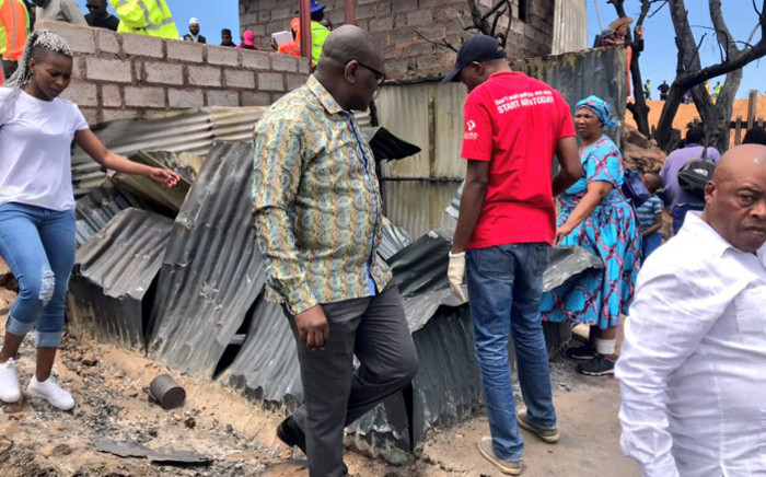 Gauteng Premier David Makhura surveys the damage in Alexandra following a fire in the area on 6 December 2018. Picture: @David_Makhura/Twitter