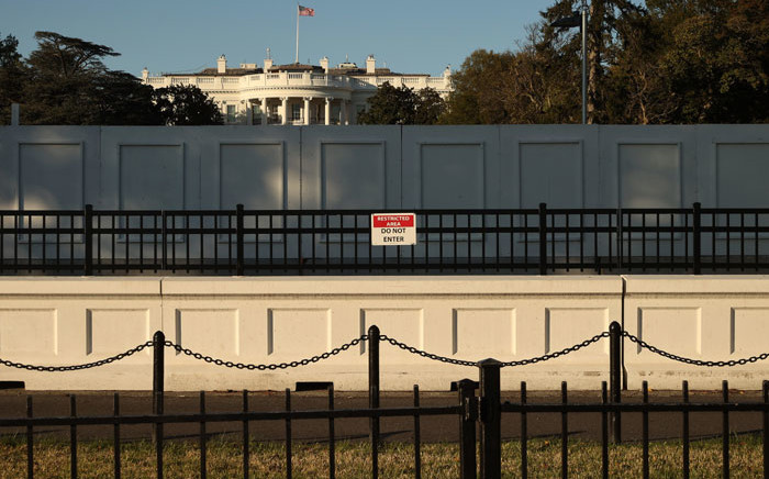 The south side of the White House on on 2 November 2020 is seen behind layers of fencing less than 24 hours before Election Day in Washington, DC. Picture: AFP