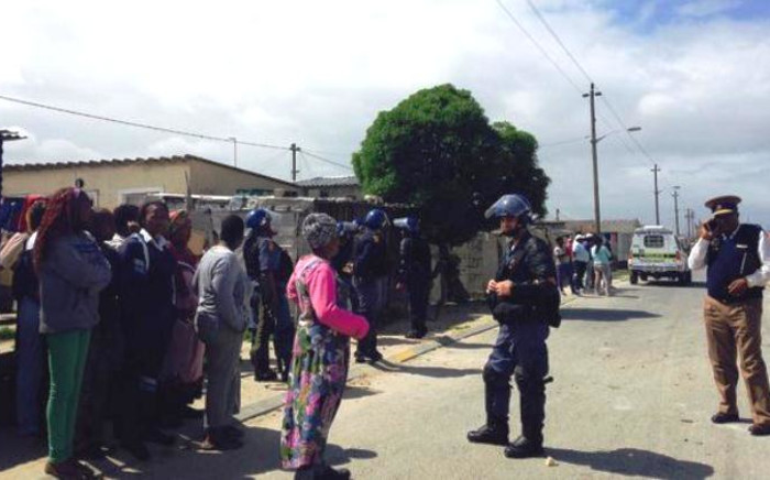 Philippi residents clash with police during protests over forced evictions on 30 September 2014. Picture: Shamiela Fisher/EWN.