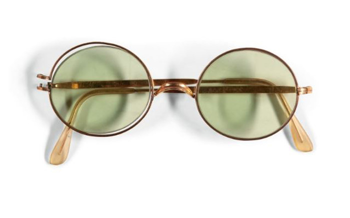 Sotheby's will action a pair of John Lennon's trademark round sunglasses in December. Picture: sothebys.com