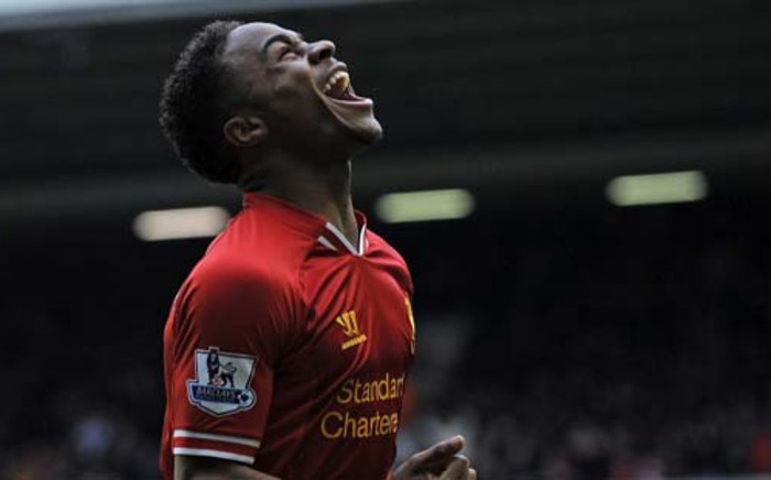 FILE: Raheem Sterling celebrates scoring their fifth goal during the English Premier League football match between Liverpool and Arsenal at Anfield in Liverpool, northwest England, on February 8, 2014. Picture: AFP.