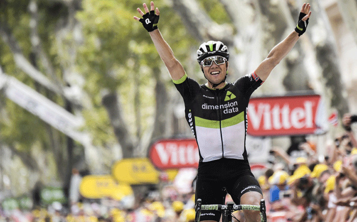 Norway's Edvald Boasson Hagen celebrates as he crosses the finish line at the end of the 222,5 km nineteenth stage of the 104th edition of the Tour de France cycling race on 21 July 2017 between Embrun and Salon-de-Provence. Picture: AFP.