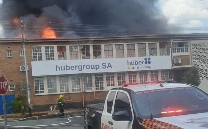 A fireman and a paramedics crew at the scene of a fire in Benrose, Johannesburg on 15 January 2020. Picture: @EMER_G_MED/Twitter
