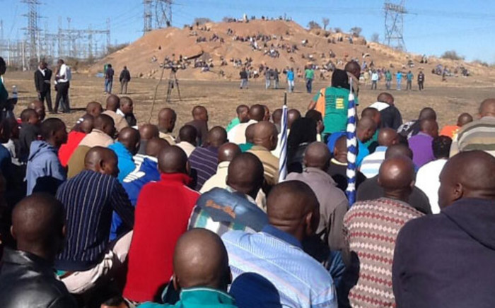 FILE: Lonmin miners gather ahead of one year anniversary at Lonmin's Marikana mine where 34 striking platinum workers were shot dead by police on 16 August 2012. Picture: Gia Nicolaides/EWN