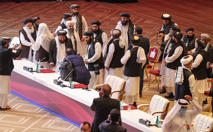 Members of the Taliban delegation leave their seats at the end of the session during the peace talks between the Afghan government and the Taliban in the Qatari capital Doha on 12 September 2020. Picture: AFP