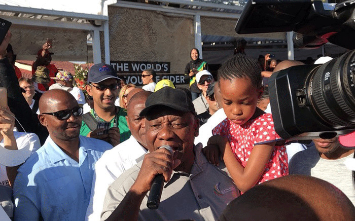 President Cyril Ramaphosa holds a child while addressing Soweto community members during a presidential walkabout on 27 October 2017. Picture: @PresidencyZA/Twitter