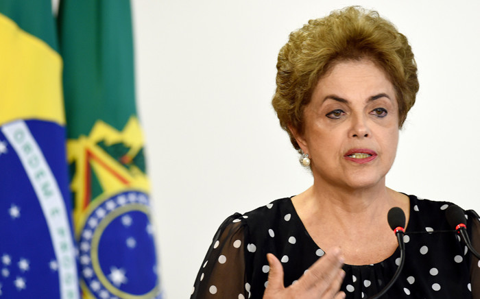 FILE. Brazilian President Dilma Rousseff attends a ceremony to renovate the leasing contract regarding the use of the Paranagua Container Terminal, at Planalto Palace in Brasilia, on 13 April, 2016. Picture: AFP.