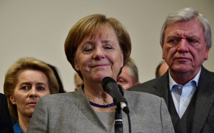 FILE: German Chancellor and leader of the Christian Democratic Union party, Angela Merkel, closes her eyes while speaking after exploratory talks on forming a new government broke down on 19 November 2017 in Berlin. Picture: AFP.