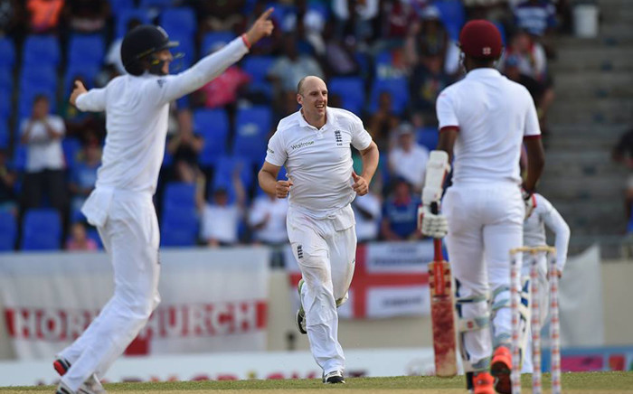 James Tredwell celebrating his wicket in their match against West Indies. Picture: ICC