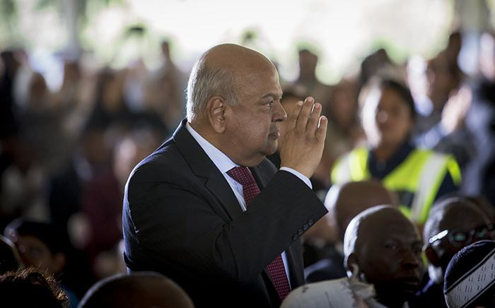 Finance Minister Pravin Gordhan salutes the crowd as they applaud him during the official state funeral of struggle stalwart Ahmed Kathrada on 29 March 2017. Picture: Reinart Toerien/EWN