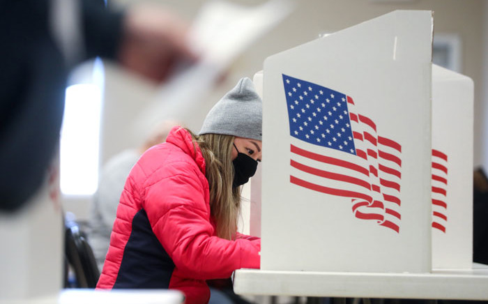 A voter marks her ballot at Bloomfield United Methodist Church on 3 November 2020 in Des Moines, Iowa. Picture: AFP
