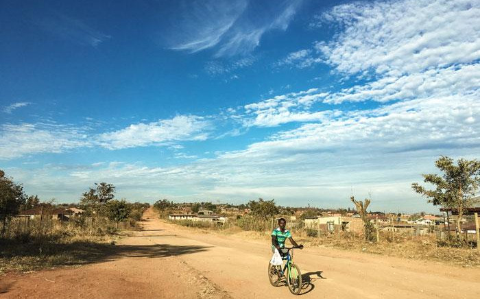 A man cycles in Vuwani as the town is shut down during protest action. Picture: Thomas Holder/EWN