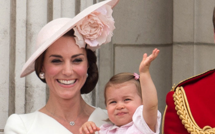 Britain's Catherine, Duchess of Cambridge holding her daughter Princess Charlotte, on the balcony of Buckingham Palace to watch a fly-past of aircrafts by the Royal Air Force, in London on 11 June, 2016. Trooping The Colour and the fly-past are part of a weekend of events to celebrate the Queen's 90th birthday. Picture: AFP.