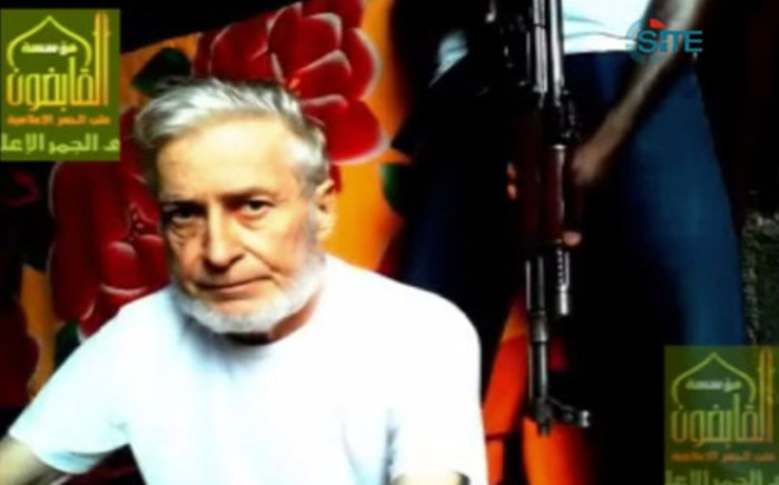 This image taken from a video released by the SITE Intelligence Group shows French enginner Francis Collomp, who is being held hostage by the Nigeria-based Ansar al-Muslimeen. In a statement, SITE reported the 3 minute, 14 second video was issued on the Sinam al-Islam jihadi forum on 27 September 2013. Picture:AFP/SITE Intelligence Group