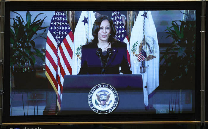 Kamala Harris, vice-president of the United States, is seen on a screen as she addresses European MPs by video, for the International Women's Day during a Plenary session at the European Parliament in Brussels on 8 March 2021. Picture: Aris Oikonomou/AFP