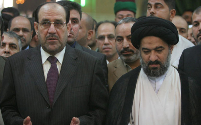 Iraq's Prime Minister Nuri al-Maliki (L) prays with Sayyed Ahmed al-Safee (R), the representative of Shiite Muslim Grand Ayatollah Ali al-Sistani, at the Imam Abbas shrine in the southern city of Karbala some 120 kilometers south of Baghdad late on 12 September, 2008. Picture: AFP