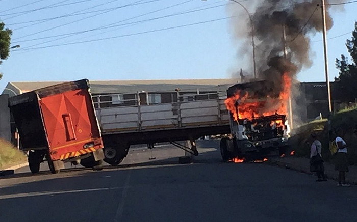 Hostel residents in Jeppe and Denver near George Goch set a truck alight on 2 March 2016. Picture: @crimeairnetwork via Twitter.