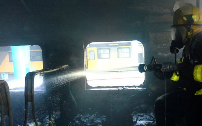 Firefighters are on scene where a train has caught alight at the Cape Town train station. Picture: Twitter.