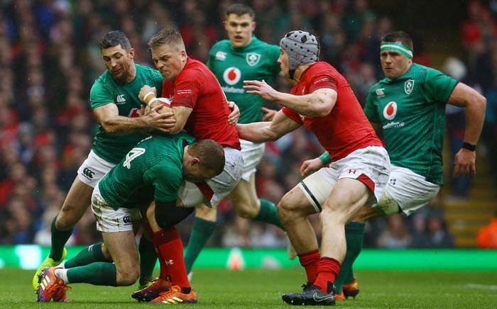 FILE: Wales' fly-half Gareth Anscombe (3rd L) is tackled by Ireland's full-back Rob Kearney (L) and Ireland's lock Tadgh Beirne (2nd L) during the Six Nations international rugby union match between Wales and Ireland at the Principality Stadium in Cardiff, south Wales, on 16 March 2019. Picture: AFP