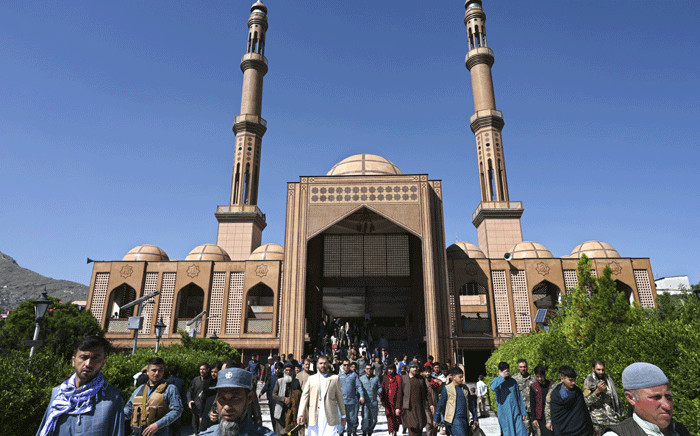 Muslim devotees leave the Abdul Rahman Mosque after offering prayers on the Eid-al-Fitr festival marking the end of the Islamic holy fasting month of Ramadan during a three-day ceasefire agreed by the warring Taliban and Afghan forces, in Kabul on May 13, 2021. Picture: Wakil Kohsar / AFP