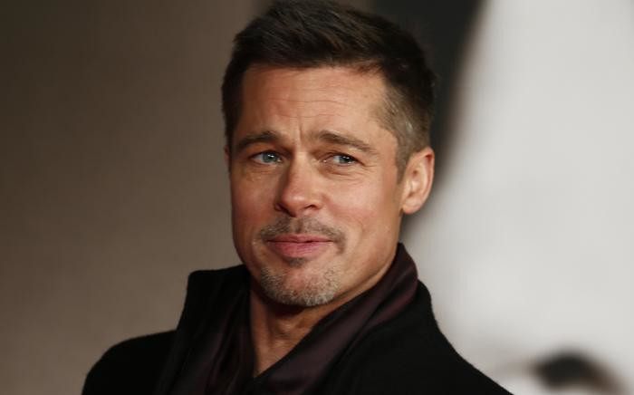 Brad Pitt poses for photographers at the UK premiere of 'Allied' in Leicester Square on 21 November 2016. Picture: AFP.